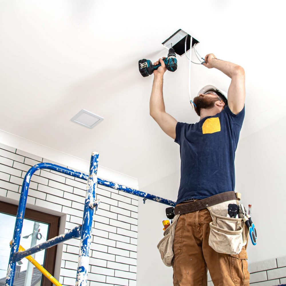 bottom-view-professional-overalls-with-tools-repair-site-home-renovation-concept (1)